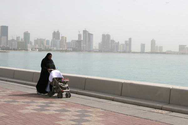 Woman walking her baby on the Corniche | Doha Corniche | Qatar