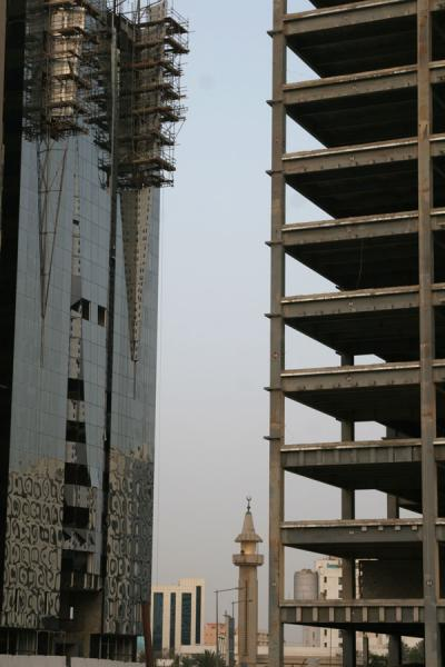 Minaret dwarfed by buildings under construction | Doha modern architecture | Qatar