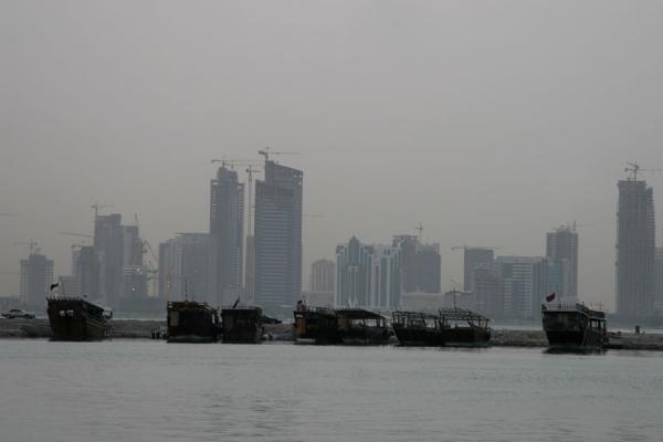 Traditional boats in the harbour and the skyline of Doha | Doha modern architecture | Qatar
