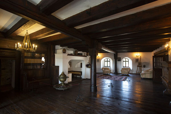 Rooms in Bran castle have dark wooden floors and thick beams in the ceiling | Bran castle | Romania
