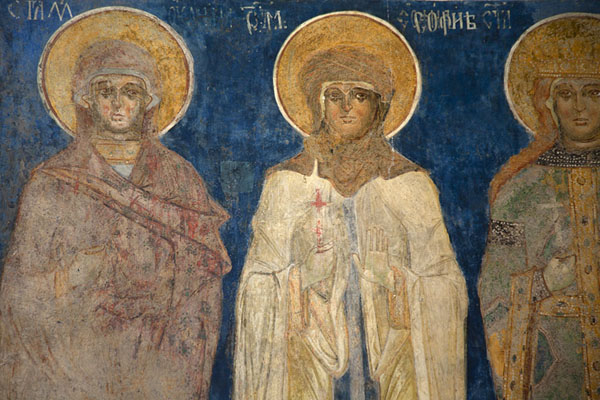 Close-up of a mural with female saints on the wall of Arbore Monastery | Bucovina monasteries | Romania