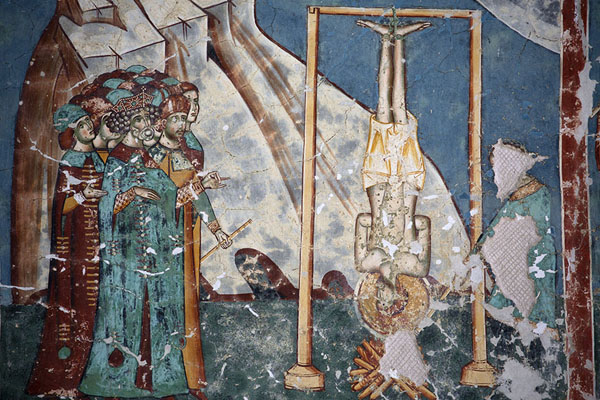 Saint hanging upside down on a mural of Arbore Monastery | Bucovina monasteries | Romania