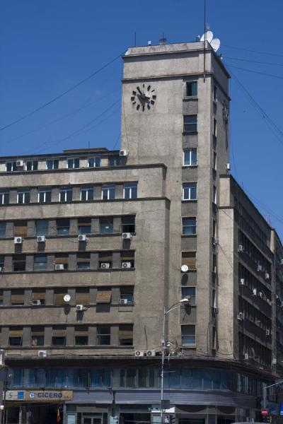 Foto di Grey building with a clock on its square tower - Rumania - Europa