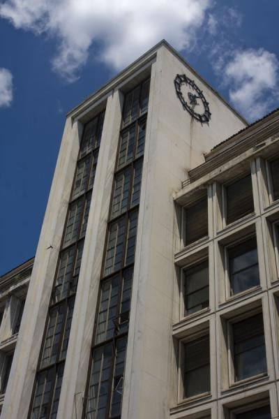 Looking up a modern building with a clock on Calea Victoriei | Calea Victoriei | Rumania