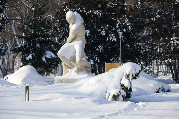 Picture of Carol Park (Romania): Statue of giant under a blanket of snow in Carol Park