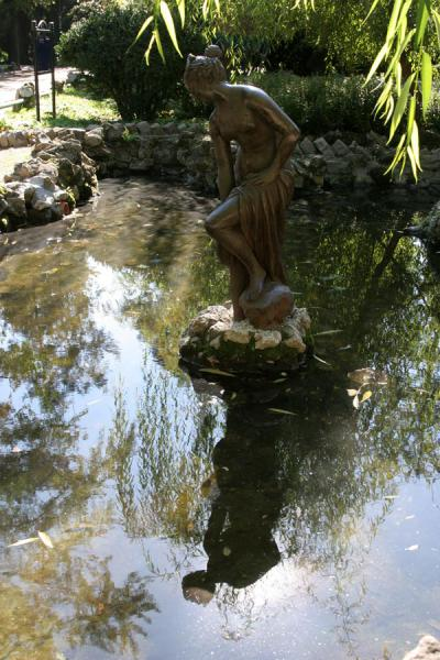 Statue reflected in a small pond in Cismigiu Gardens | Cismigiu Gardens | Romania