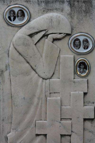 Weeping woman, crosses and pictures on a family tombstone | Ghencea Cemetery | Romania
