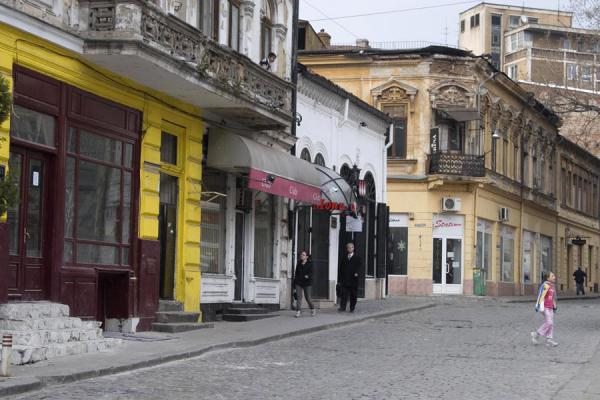 Romanian girl playing in the streets of Lipscani quarter | Lipscani historic quarter | Romania