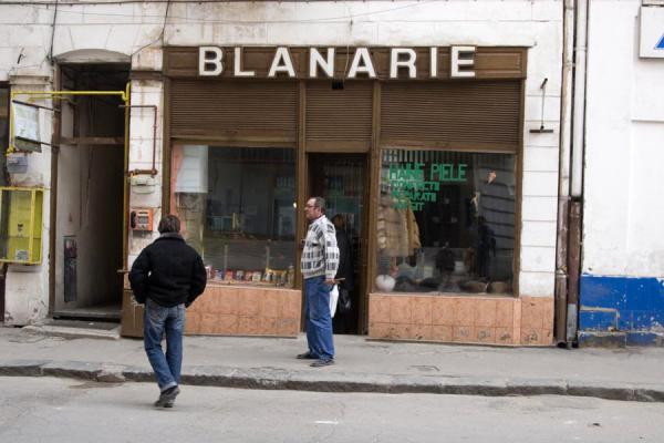 Picture of Lipscani historic quarter (Romania): Shop in the historic quarter with chatting men