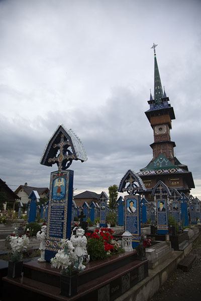 Looking up the cemetery and the quirky bell-tower of the adjacent church | Cimitero alegro | Rumania