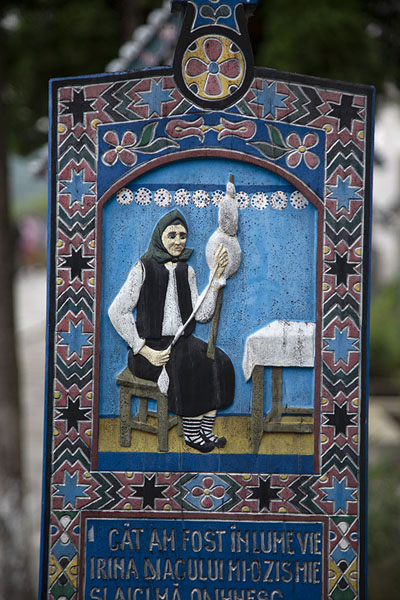 Cross with woman spinning wool | Merry Cemetery | Romania