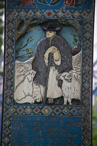 Shepherd with his sheep depicted on a cross at the cemetery | Vrolijke begraafplaats | Roemenië