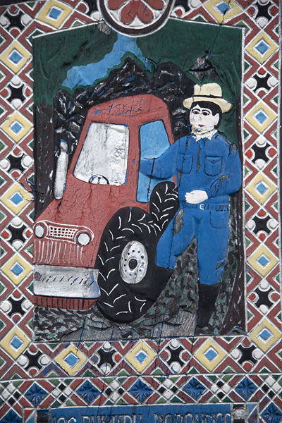 Farmer with his tractor depicted on a cross | Merry Cemetery | Romania