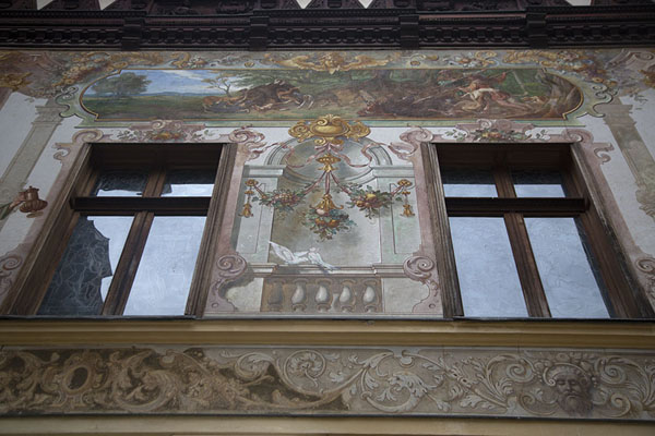 Foto di Looking up a wall with mural in the inner courtyard of Peleș castleSinaia - Rumania