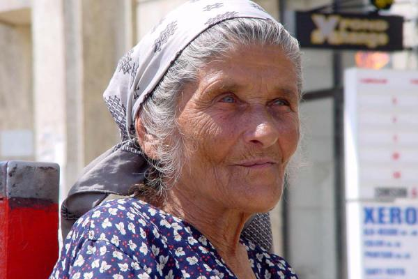 Picture of Romanian people (Romania): Old Romanian woman in the streets of Bucharest
