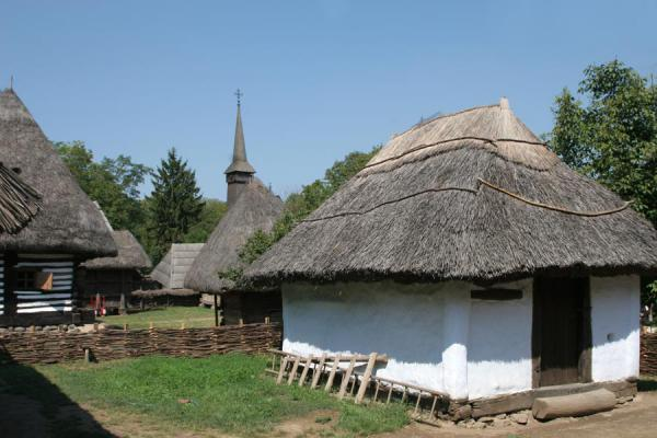 Houses and church in the background | Museo del Pueblo Satului | Rumania