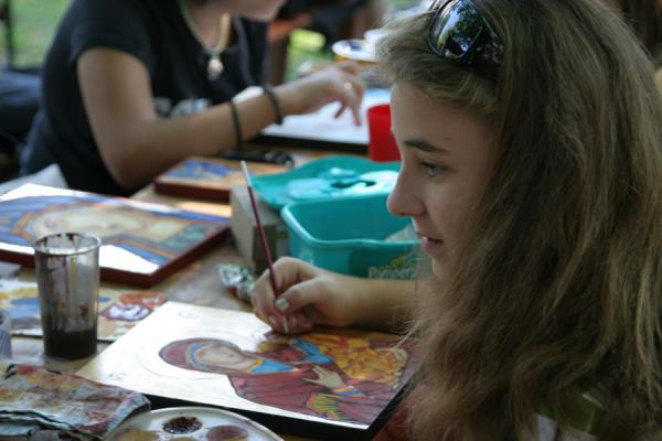 Girl learning to paint religious icons | Musée du village Satului | Roumanie