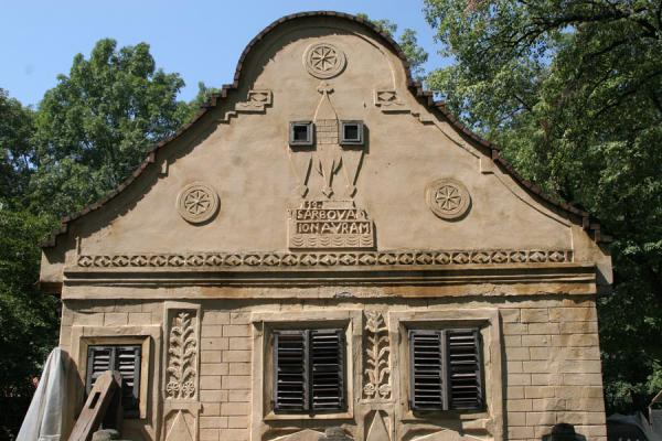 Facade of stone house with inscriptions in the Village Museum | Musée du village Satului | Roumanie