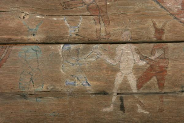 Painting of devils on the outside of wooden church | Dorpsmuseum Satului | Roemenië
