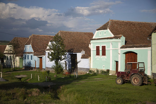 Picture of Viscri (Romania): Main street of Viscri with row of pastel-coloured houses