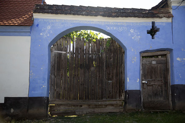 Wooden gate in a blue wall in Viscri | Viscri | Romania