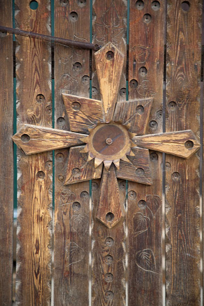 Detail of wooden door with cross | Esso | Russie