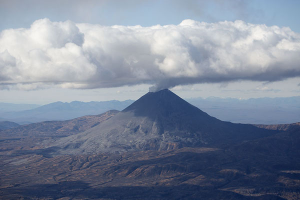 Cloud of smoke hanging above Karymsky volcano | Kamchatka from the air | Russia