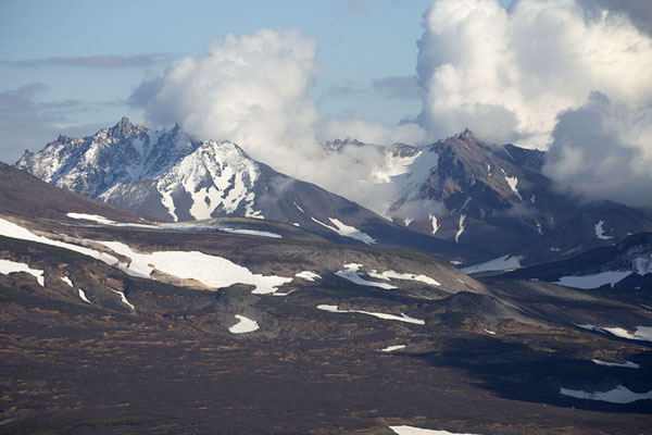 Clouds and snow-covered mountains in central Kamchatka | Kamchatka from the air | Russia