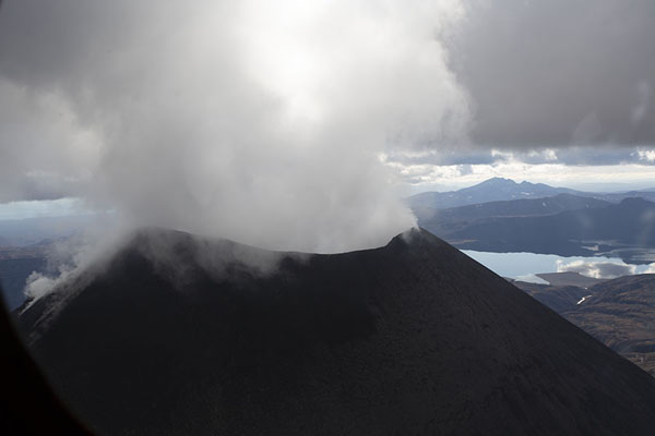 Constant pillar of smoke coming out of Karymsky volcano | Kamchatka from the air | Russia
