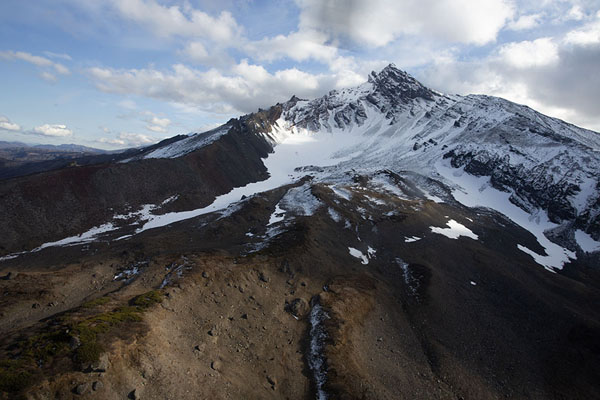 Snowy slopes of a mountain in Nalychevo park in central Kamchatka | Kamchatka from the air | Russia