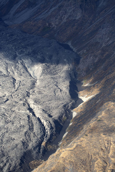 Recent lava field on the slopes of Karymsky volcano | Kamchatka from the air | Russia