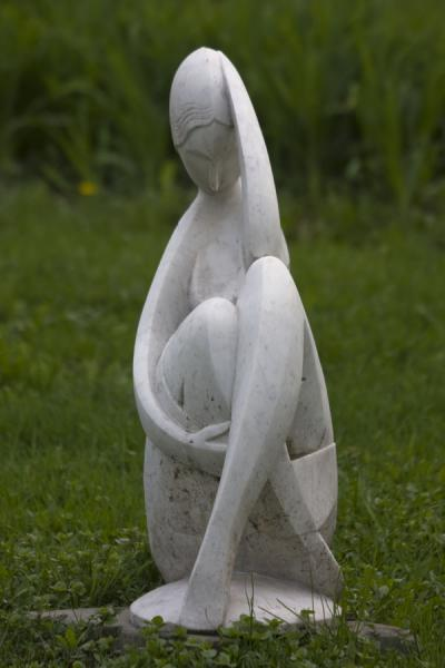 Elegant white woman on the grass in the Sculpture Park | Sculpture Park | Russia