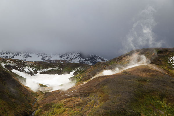 Picture of Small Valley of the Geysers with steam above the surrounding hills - Russia - Europe