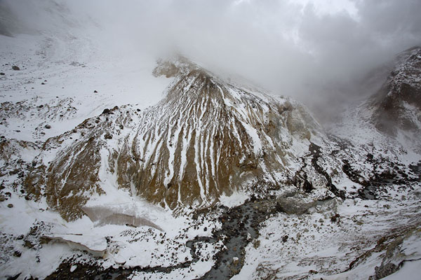 Picture of Inside view of the crater of Mutnovsky volcano with mountain stream and snowy mountains - Russia - Europe
