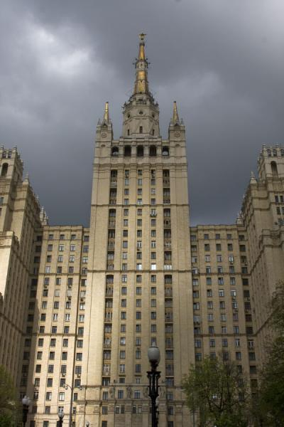 Picture of Frontal view of the Kudrinskaya Apartment Block with dark skies behind it - Russia - Europe