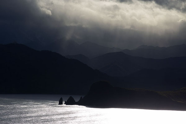 Picture of Three Brothers Peninsula (Russia): Sun filtering through clouds over the west side of Avachinsky Bay