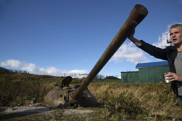 Russian pushing the barrel of a cannon on top of the cliffs at the south of the peninsula | Three Brothers Peninsula | Russia
