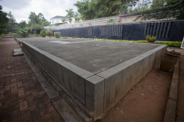 The burial site with the long wall partly covered with names | Kigali Genocide Memorial Centre | Rwanda