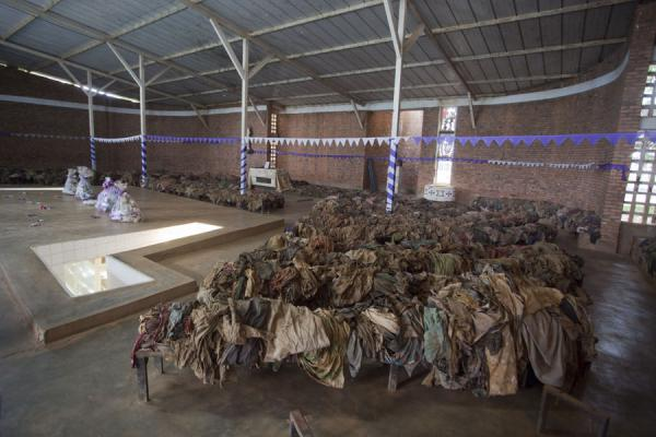 Remains of clothes on the benches inside the church where people once prayed | Nyamata Genocide Memorial | Rwanda
