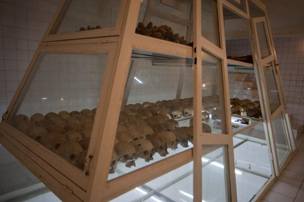 Glass showcase with skulls and bones under the church | Nyamata Genocide Memorial | Rwanda