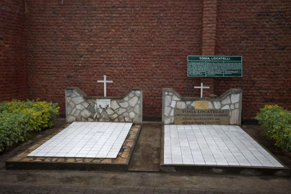 The tomb of Tonia Locatelli, an Italian nun who saved many people, outside the church wall | Nyamata Genocide Memorial | Rwanda
