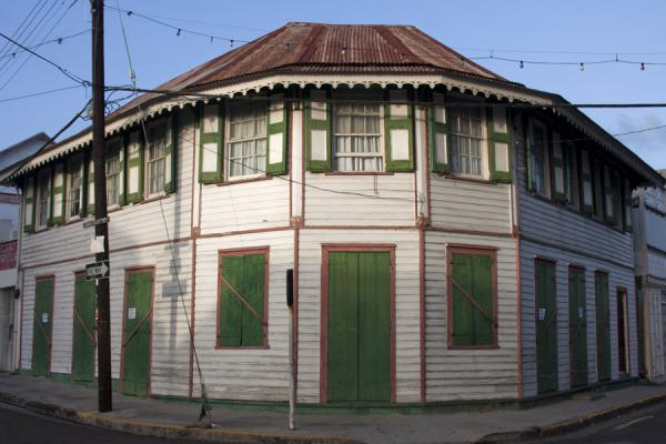 Picture of Basseterre (Saint Kitts and Nevis): Green and white house in the streets of Basseterre