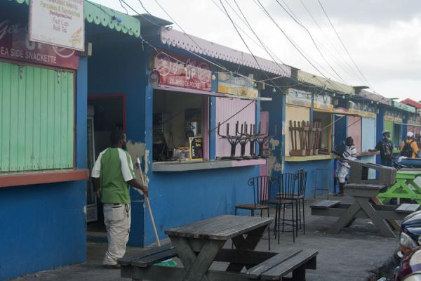Picture of Basseterre (Saint Kitts and Nevis): Shacks in bright colours at the bus station of Basseterre