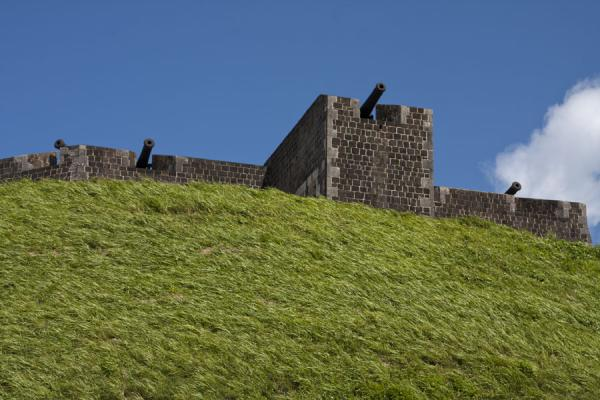 Picture of Brimstone Hill Fortress (Saint Kitts and Nevis): Thick defensive walls topped by cannons on the Fort George citadel