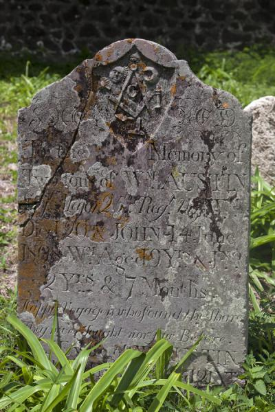 Picture of Brimstone Hill Fortress (Saint Kitts and Nevis): One of the old tombstones on the cemetery of Brimstone Hill fortress