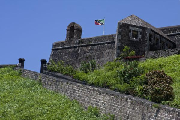 Picture of Brimstone Hill Fortress (Saint Kitts and Nevis): Looking up the entrance to Fort George citadel with the flag of St Kitts and Nevis