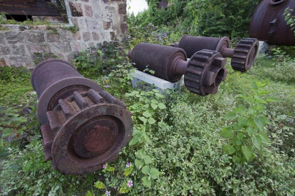 Picture of Nevis Plantations (Saint Kitts and Nevis): Rusty parts of sugar processing machines in the New River estate plantation