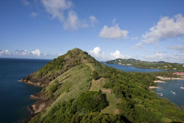 View of Pigeon Island with causeway and Signal Hill, the northern coast of Saint Lucia, and in a distance, Martinique | Pigeon Island | Santa Lucia