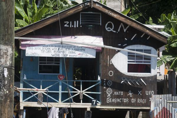 Picture of House with slogans painted on the wooden walls in the outskirts of Soufrière