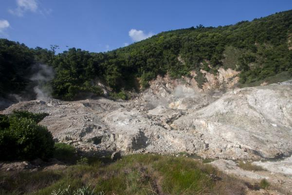 Overview of the sulphur springs area, appearing like a gap in the forest | Sources de soufre de Soufrière | Sainte Lucie